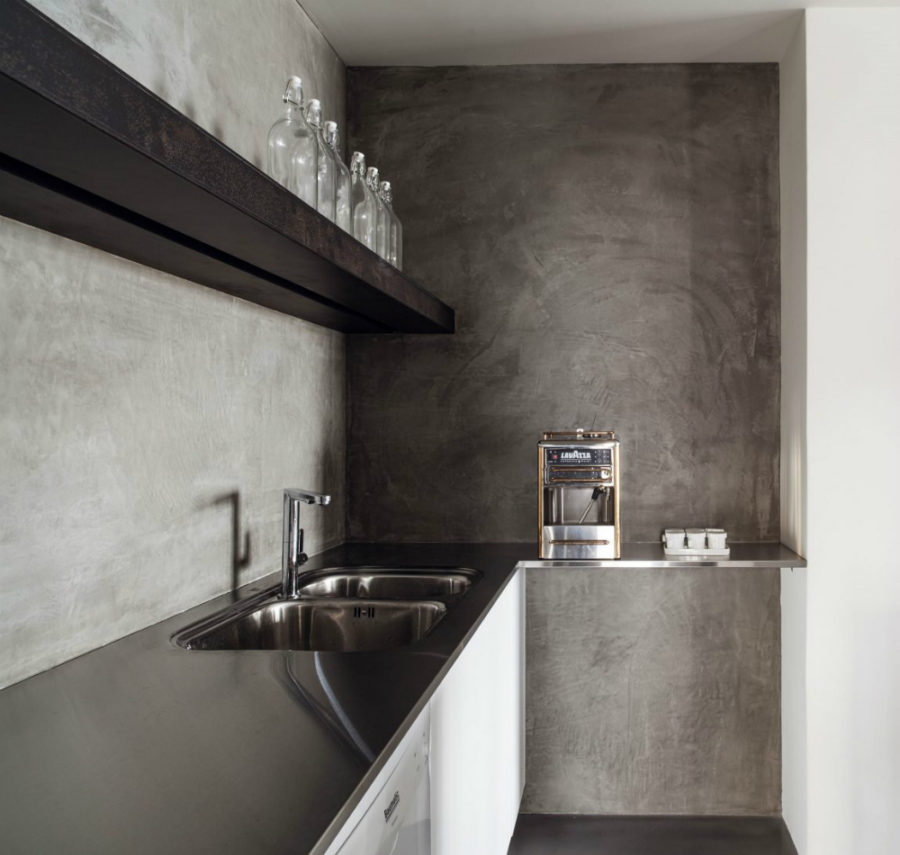 Concrete kitchen with stainless steel countertops