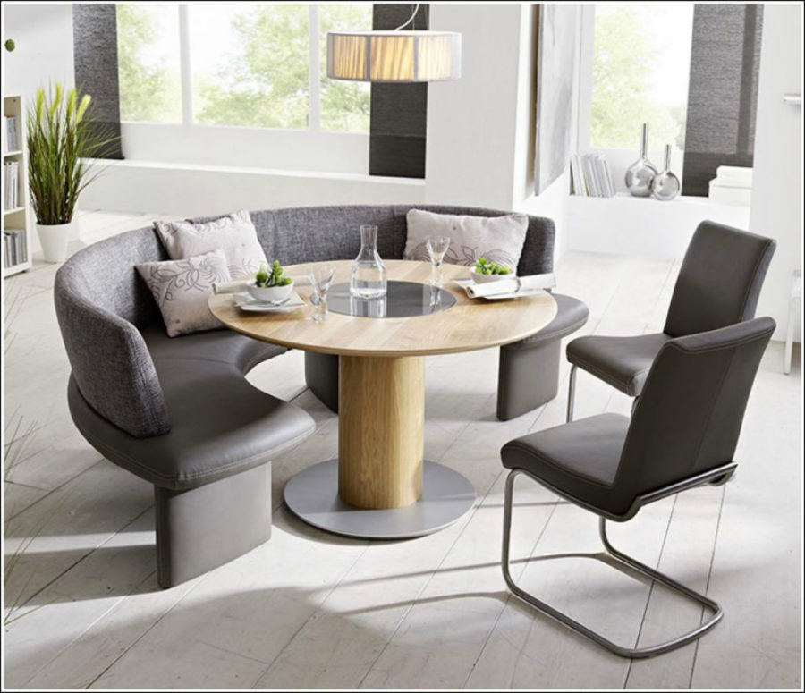 Contemporary dining room with a curved seat