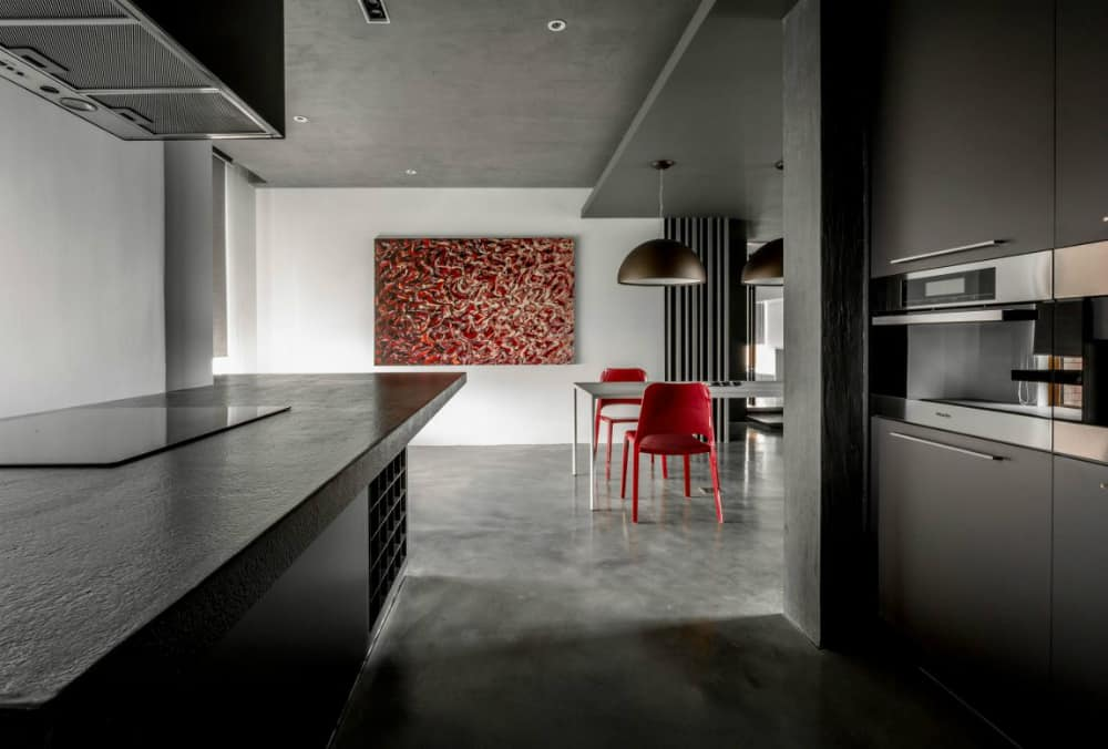 Dining area comes with a pop of contrasting red