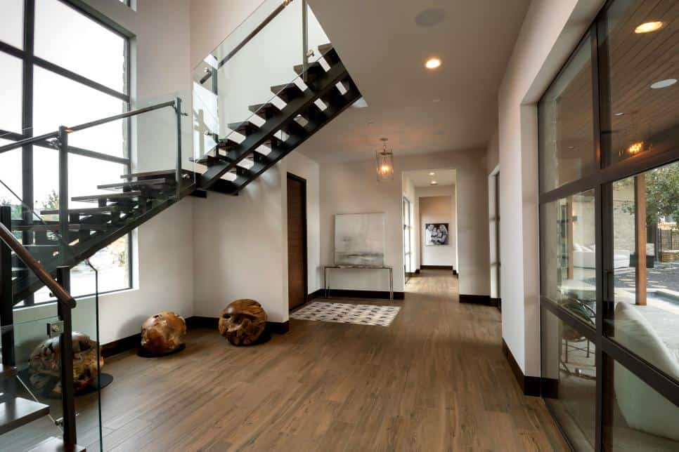 Dramatic modern foyer by Carrie Maniaci