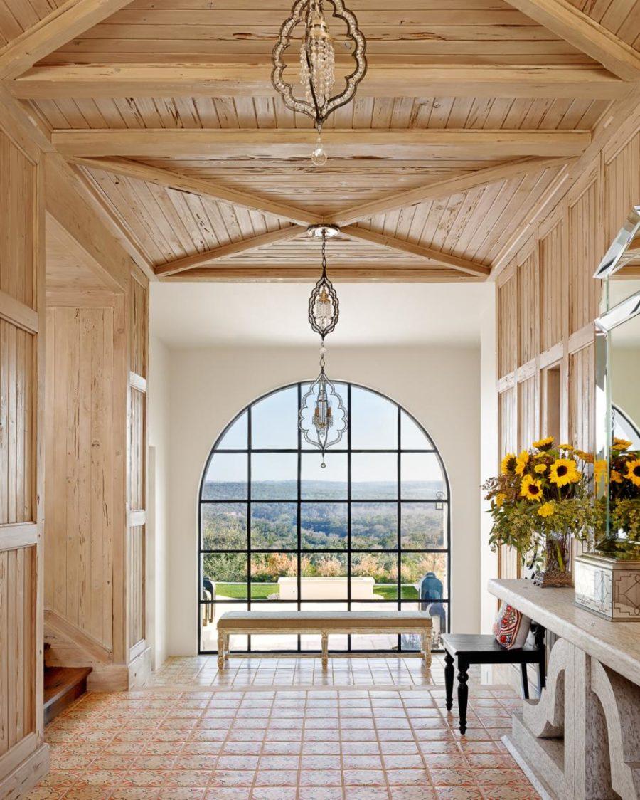 Dramatic rustic hallway by Hugh Jefferson Randolph Architects