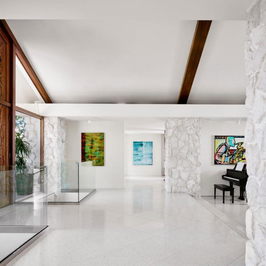Dramatic white entryway by Hugh Jefferson Randolph Architects