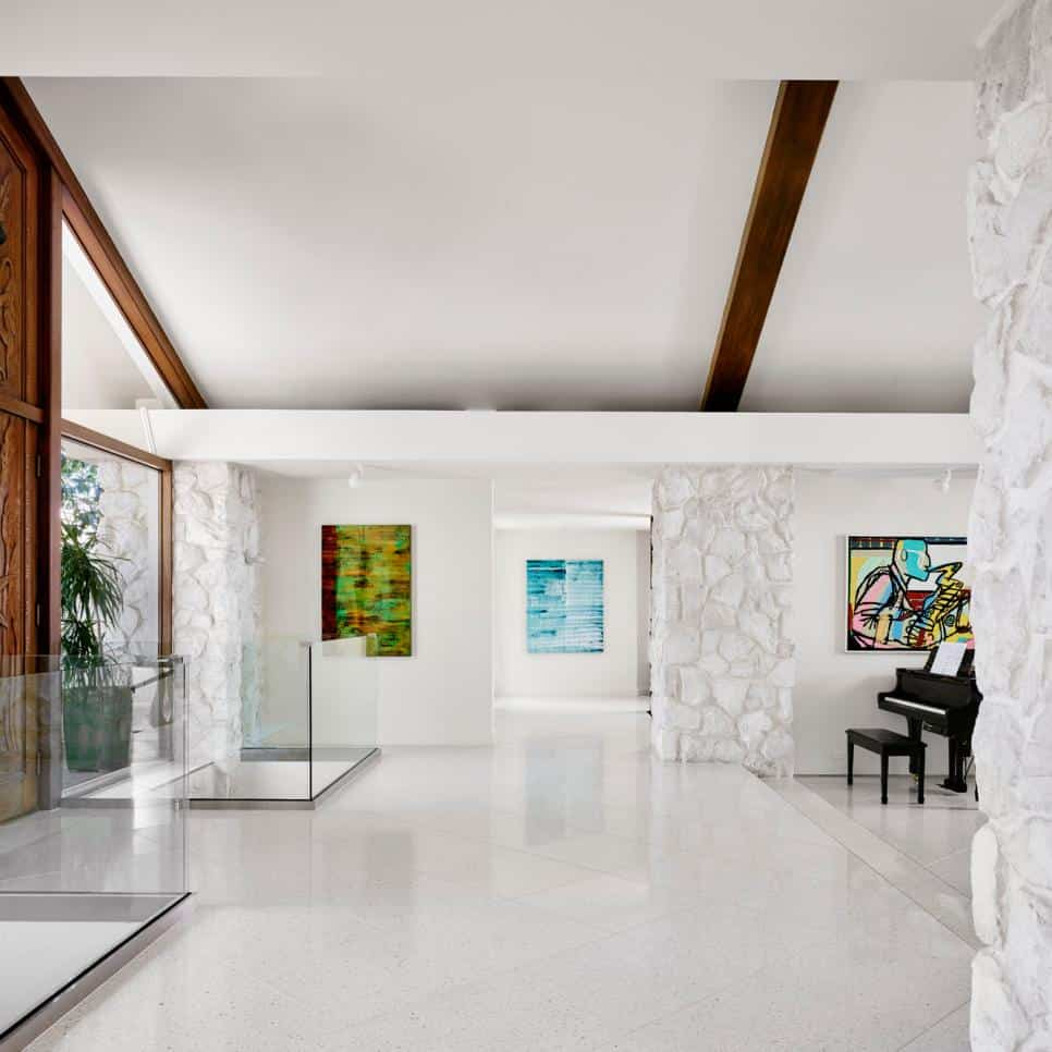 Dramatic white entryway by Hugh Jefferson Randolph Architects