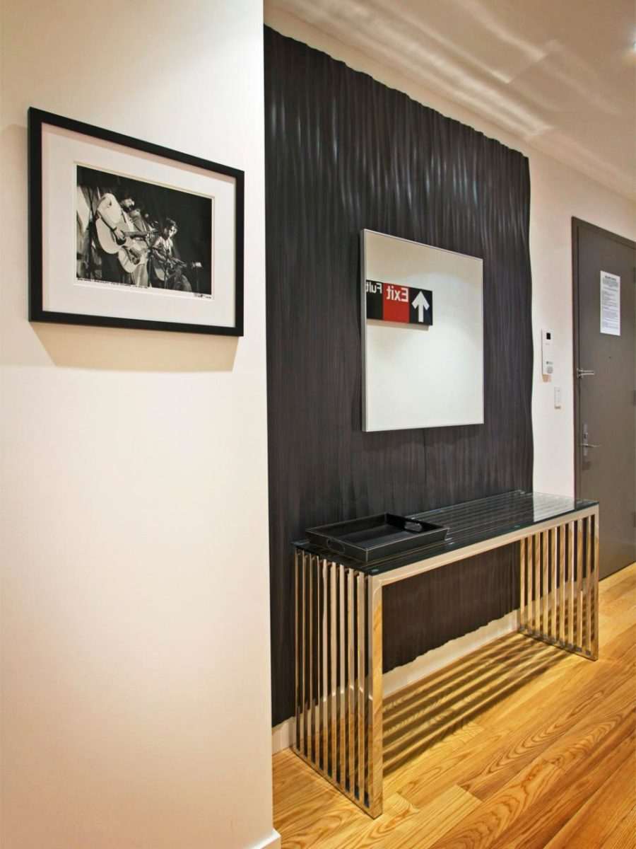 Ebony Accent Wall and Modern Art by Vanessa DeLeon