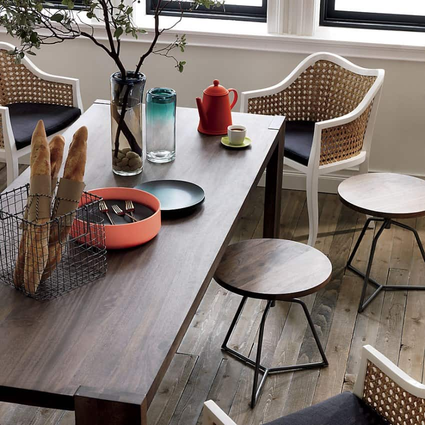 Eclectic dining room with stools and chairs