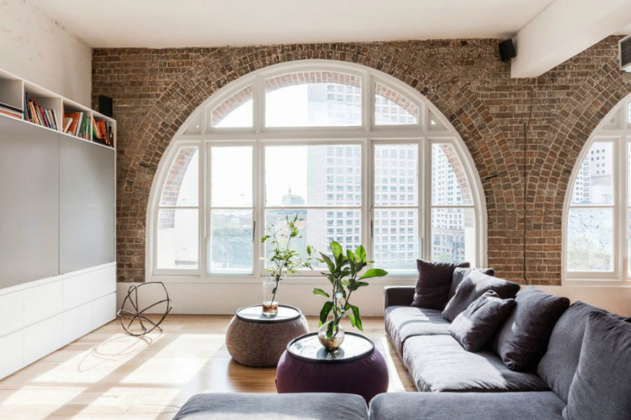 Exposed brick decorating arching windows 900x600 Contemporary Home That Makes the Most of Old Brick Building