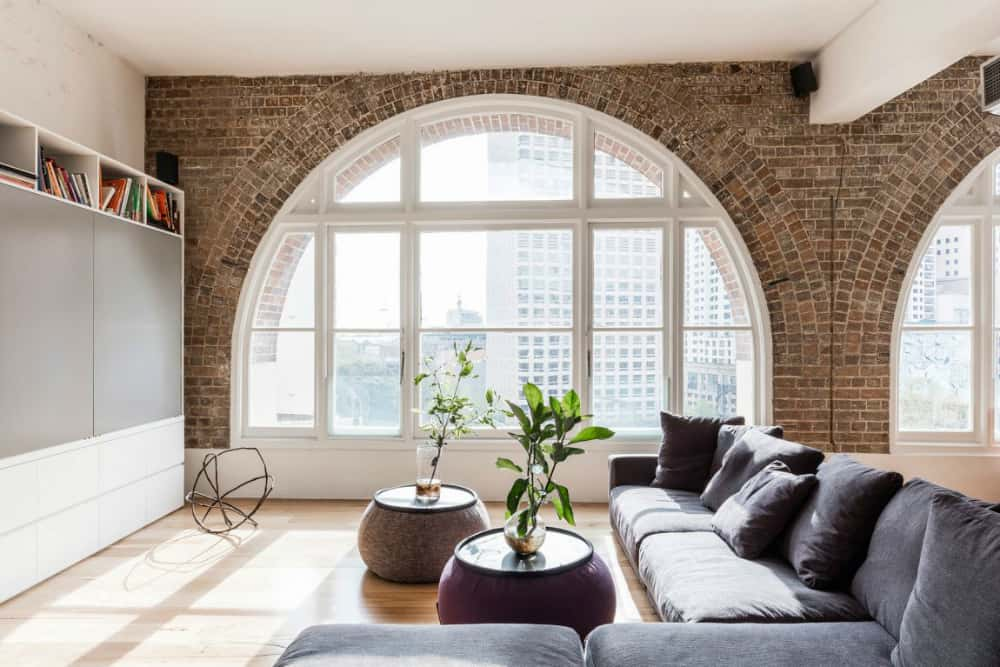 Exposed brick decorating arching windows