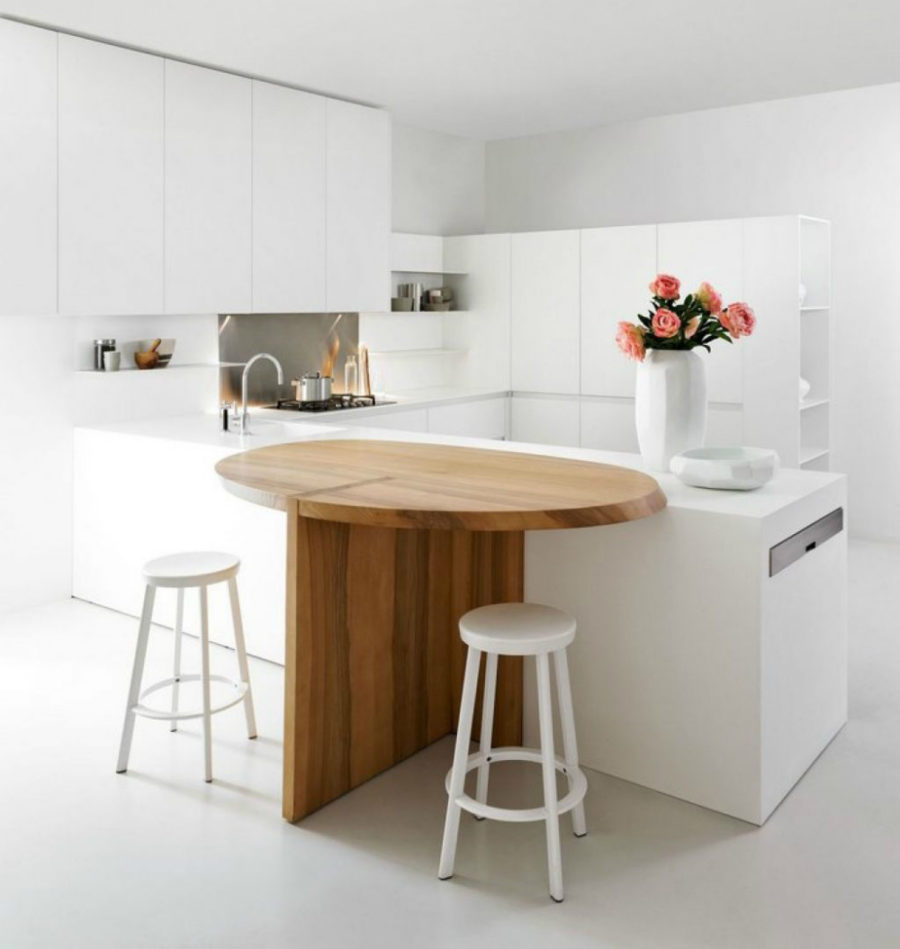 Extendable kitchen island work surface with a breakfast corner