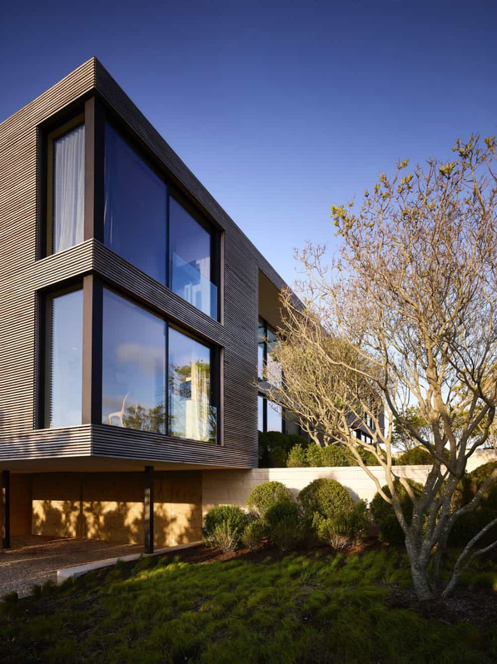 Flattering wooden siding interchanges with reflective windows