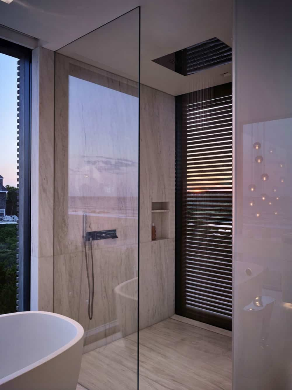Glass corner shower stall features a screened window