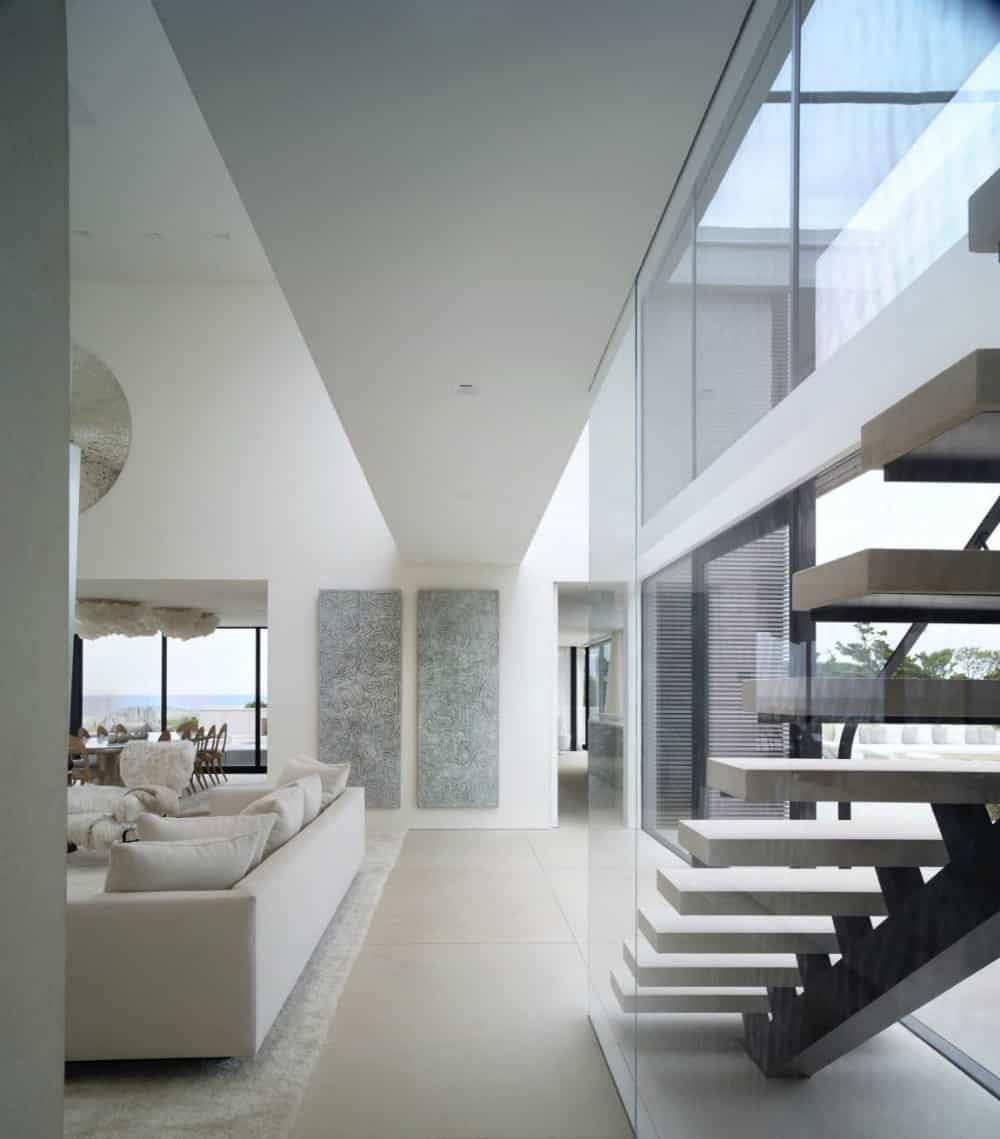 Glass-encased staircase has a very fitting contemporary