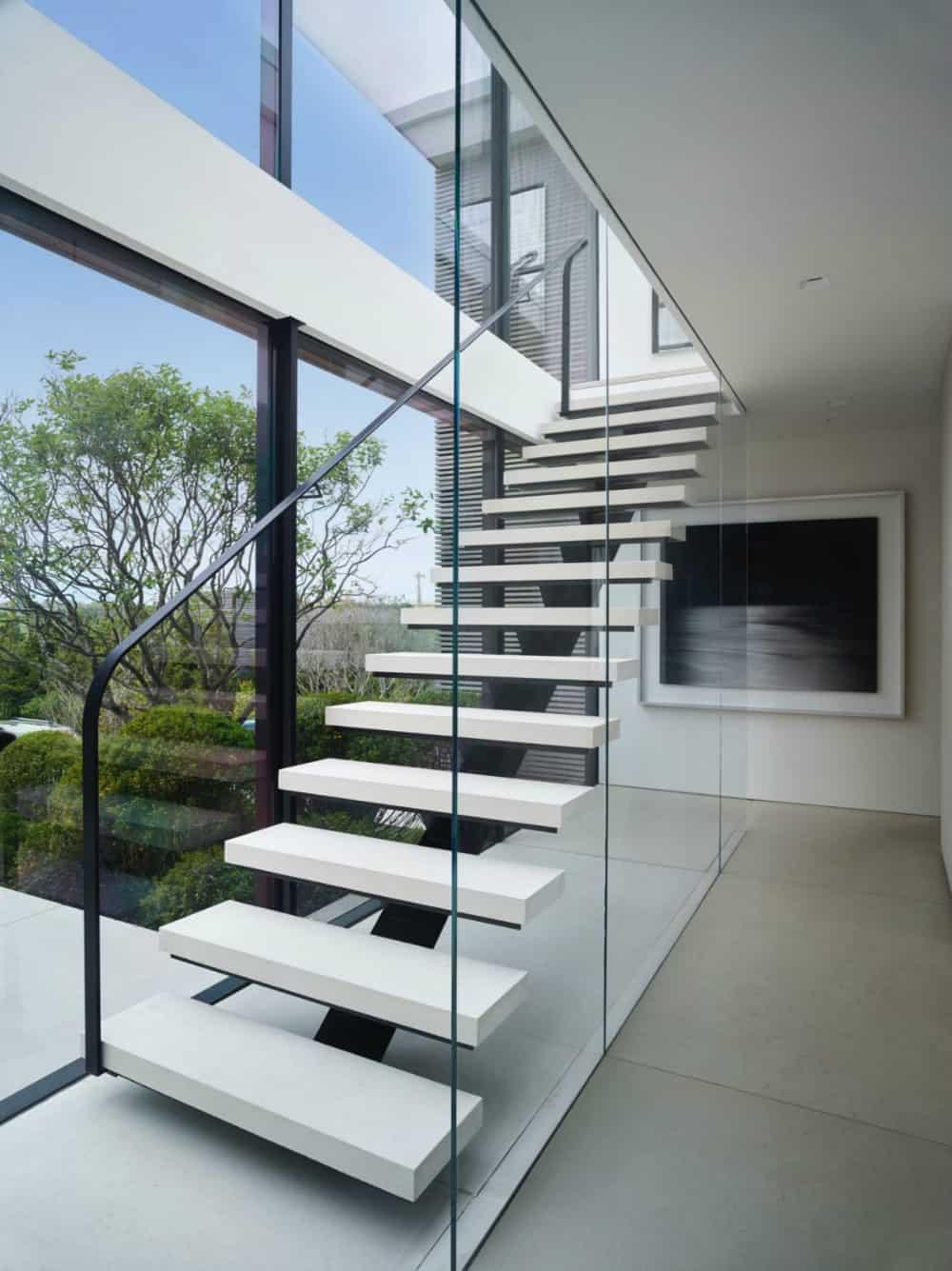 Glass wall opens up to immediate greenery