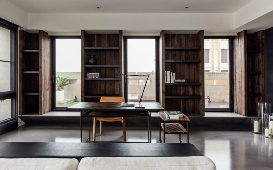 Home office adjoins the living room contributing to the contemporary open layout 900x561 This Stylish Concrete Home in Taipei is Refined Simplicity