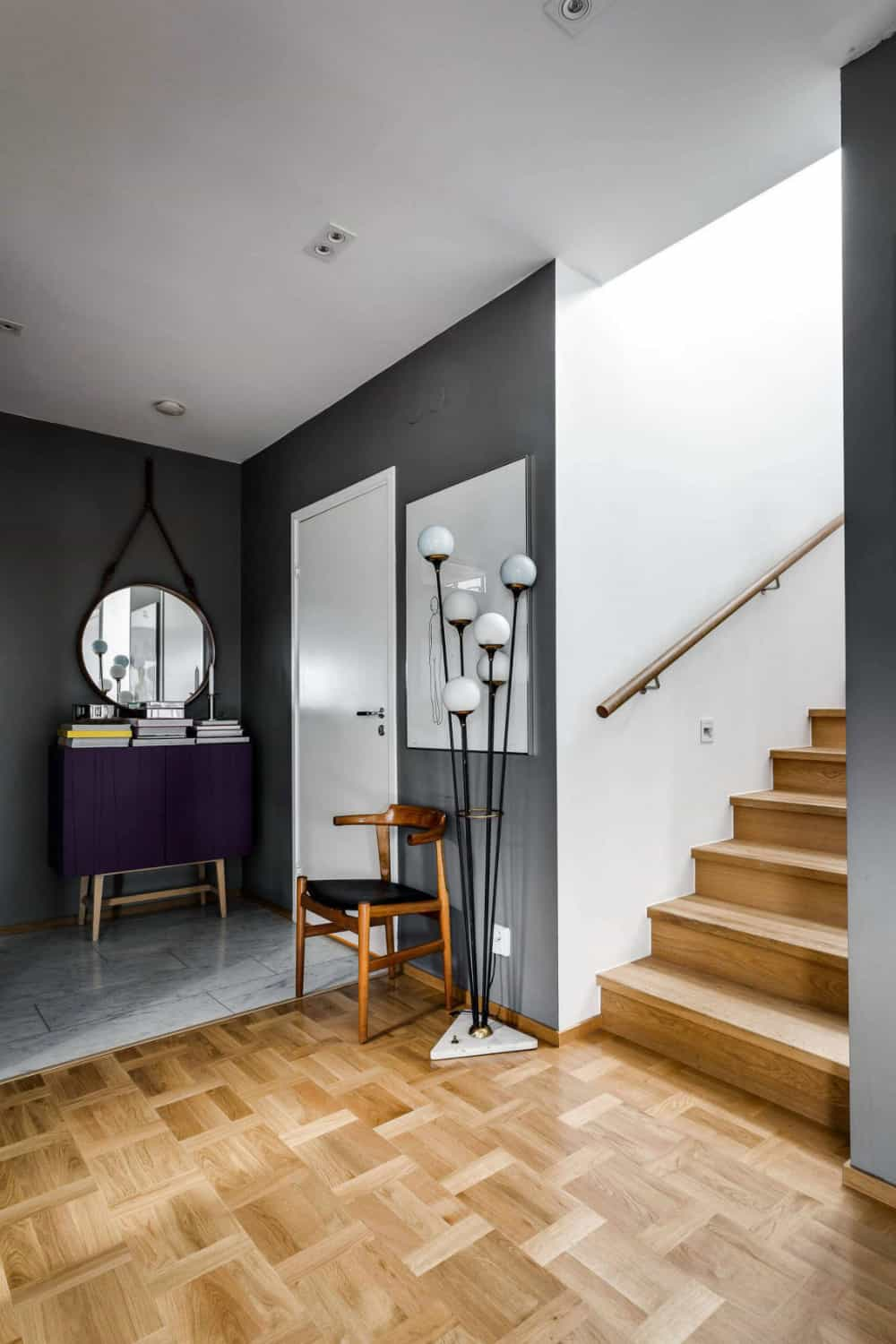 Immediately flooring changes from stone tiles to parquet