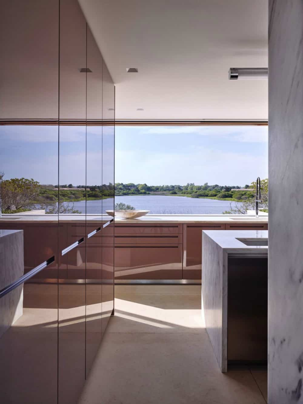 Kitchen is full of light and views
