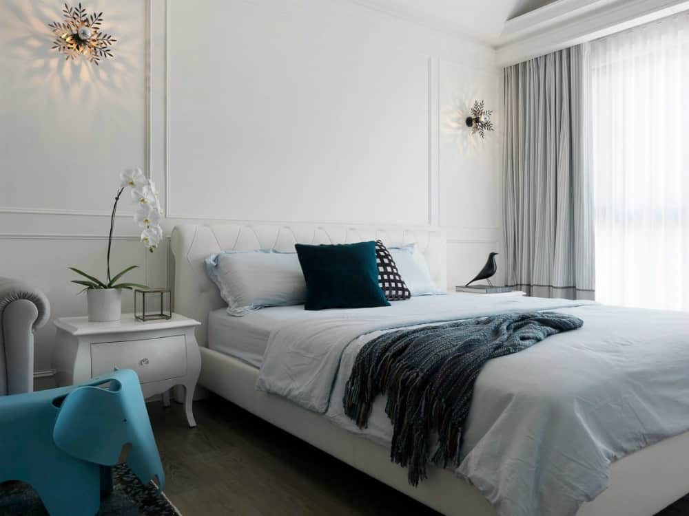 Leather bed frame goes well with wall molding