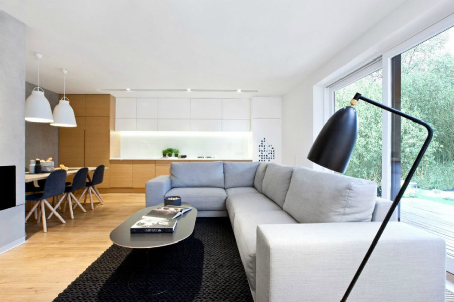 Living area is contemporarily simple 900x599 Contemporary Polish Home Uses Texture and Color as Accents