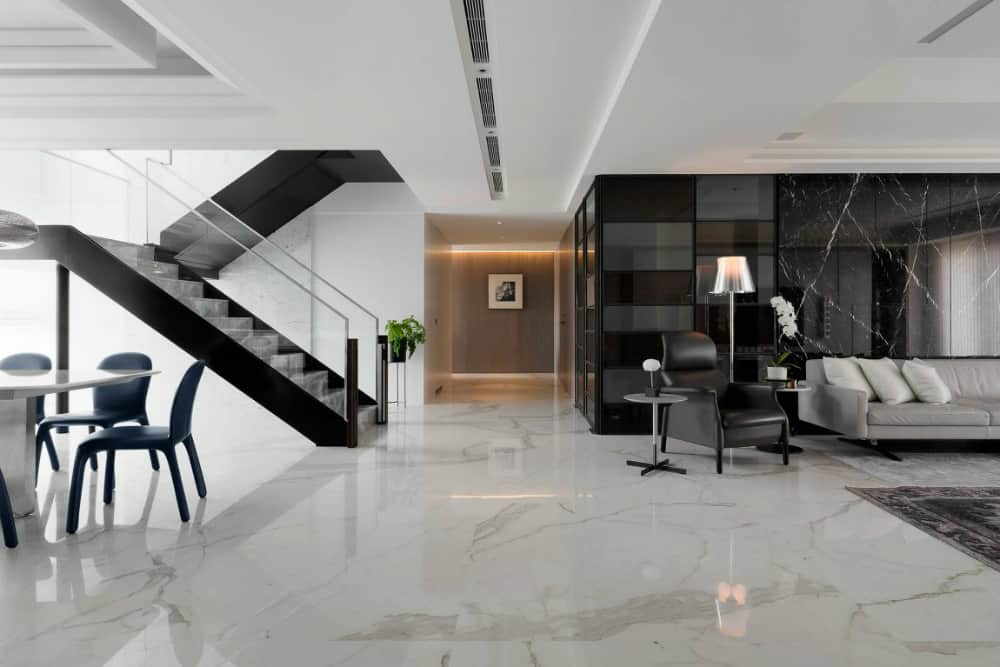 Living room feature wall features black marble