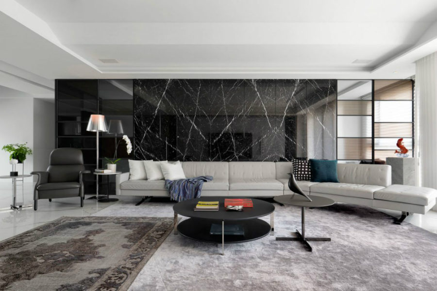Long sectional sofa can accommodate quite a few guests 900x600 This Taiwanese Apartment is Luxuriously Contemporary