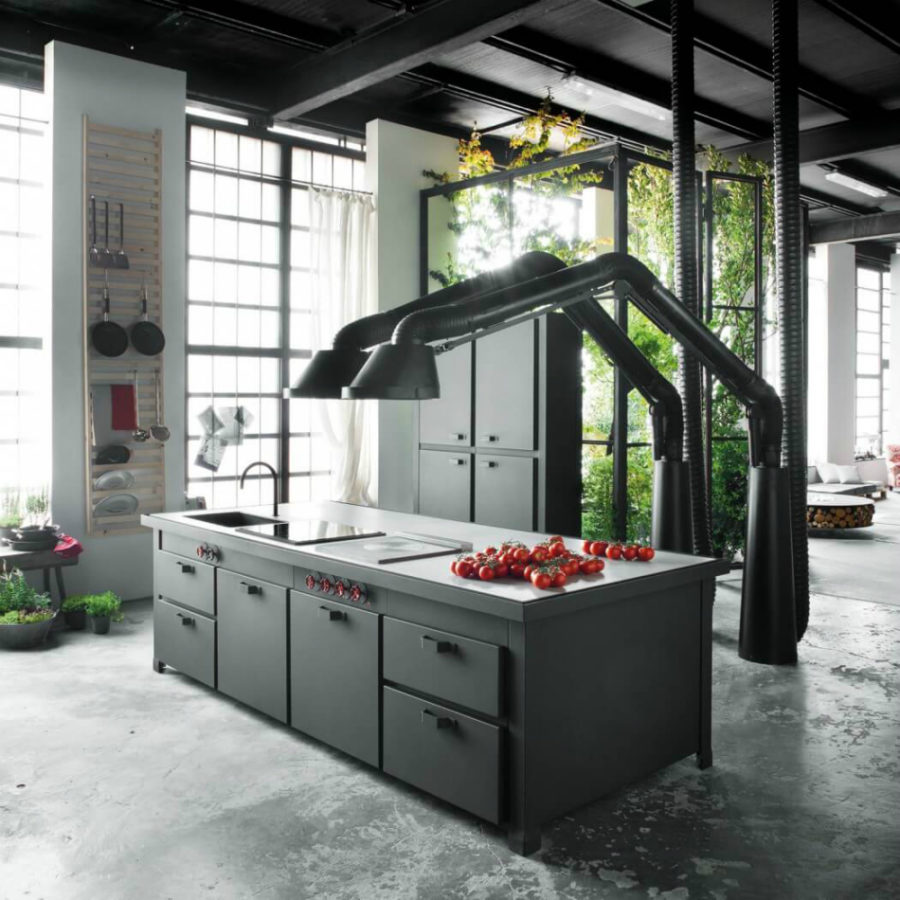 Mammut extractor hoods decorate the kitchen with concrete floors