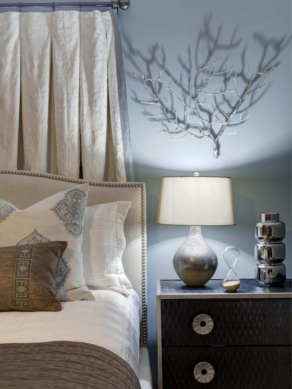 Metallic wall hanging in a bedroom by Erica Lugbill