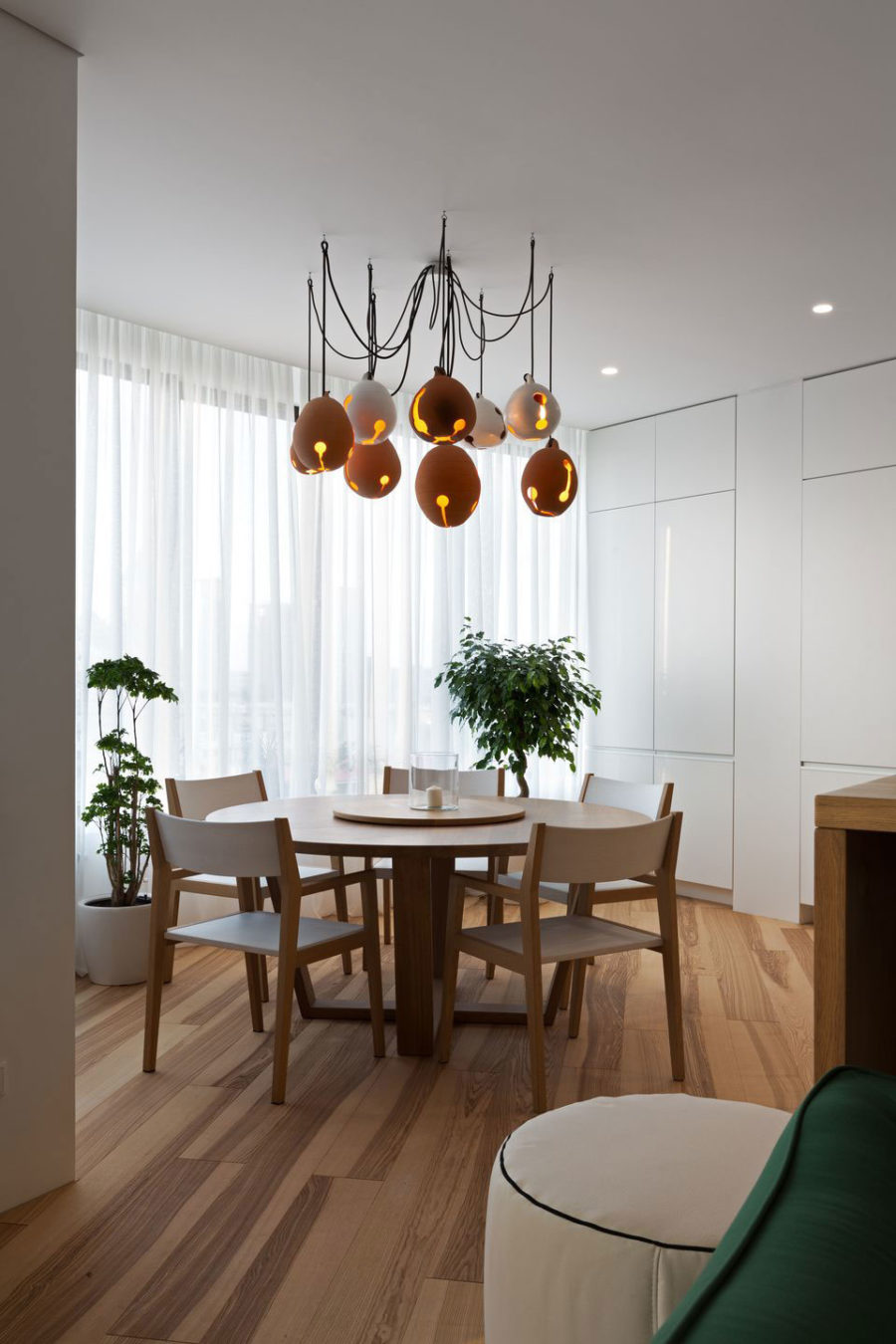 Minimal interior gets a pop with unique accessories like these dining room lights