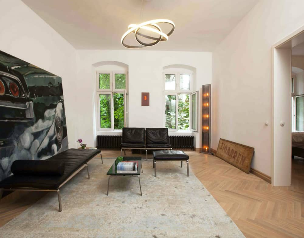 Minimal living room furnished with leather chairs