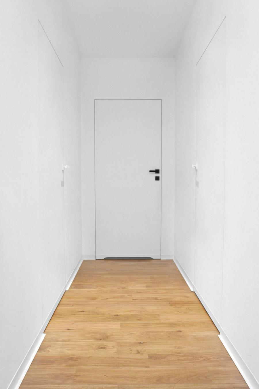 Minimal white hallway looks sterile