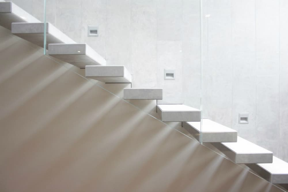 Modern staircase has safety lights built into the wall every three steps