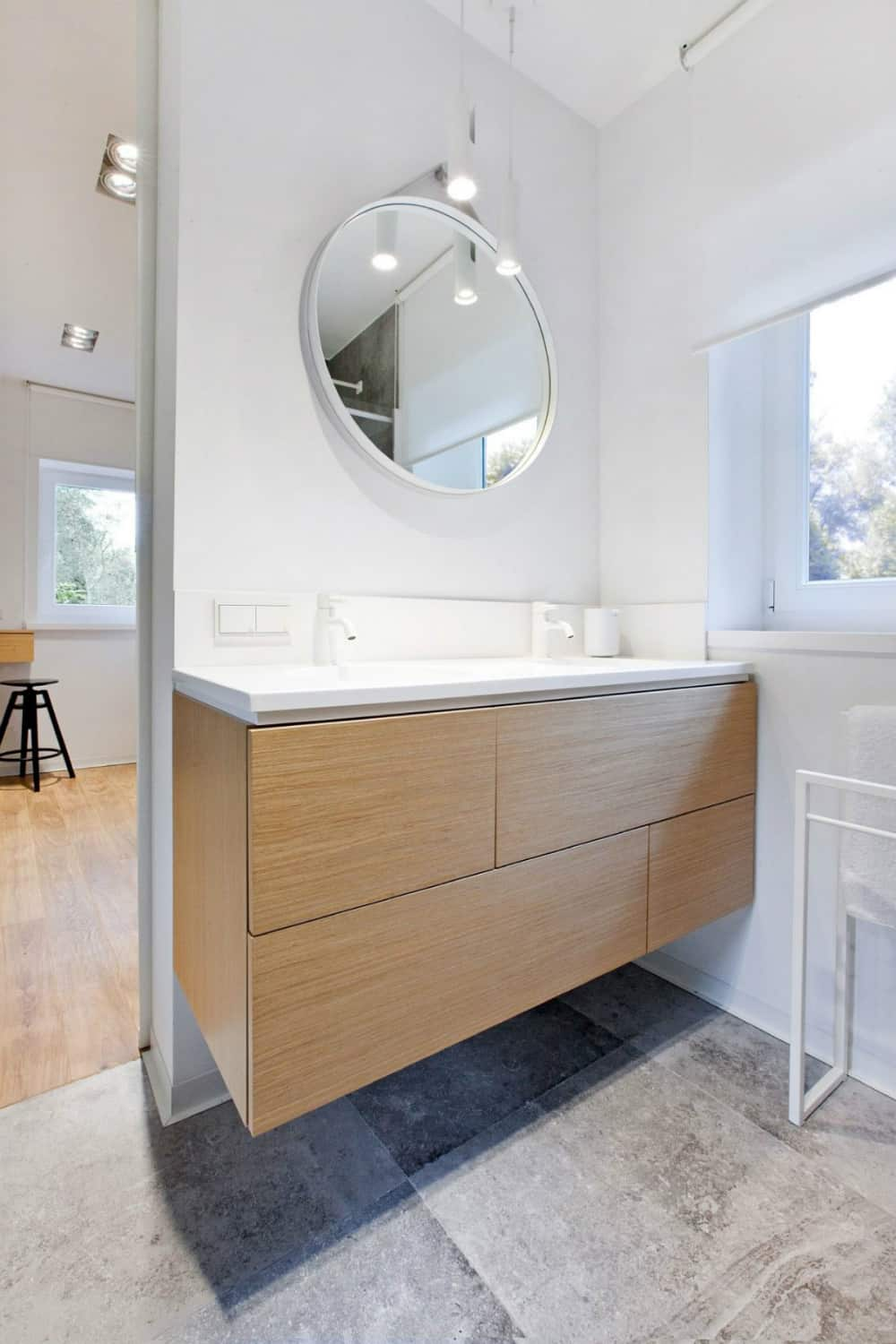 Modest bathroom echoes the kitchen with white hardware