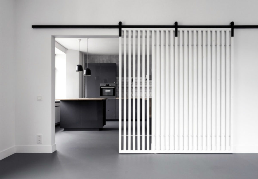 Moving slat wall door