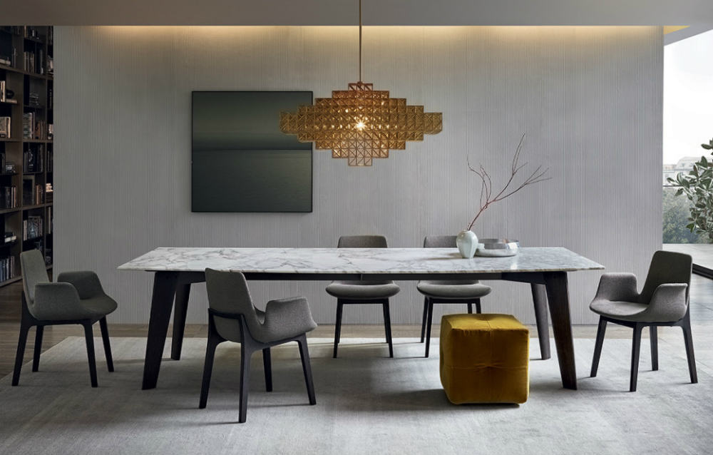 Mustard pouf in a grey dining room