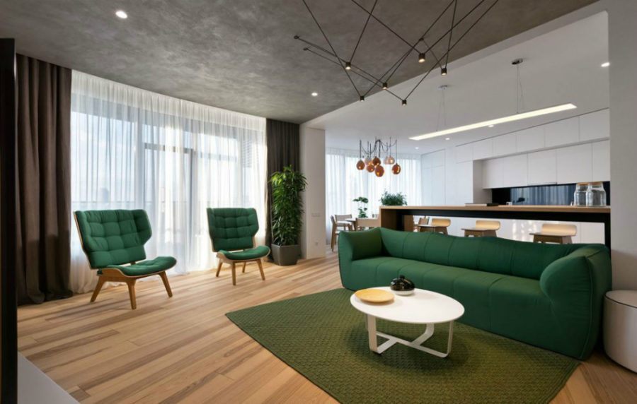 Open plan living room flows into kitchen 900x572 Minimal Apartment in Kiev Has a Lot to Show