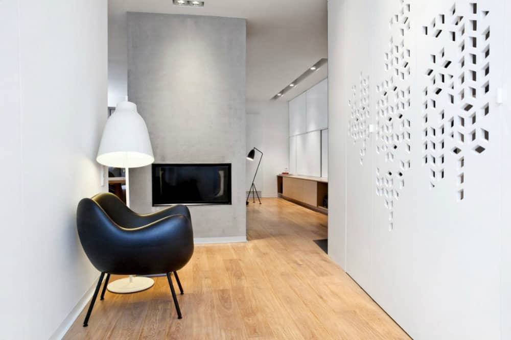 Perforated wall adds detail to a minimal interior