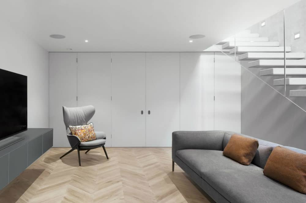Plenty of storage is neatly hidden behind minimalist closet doors