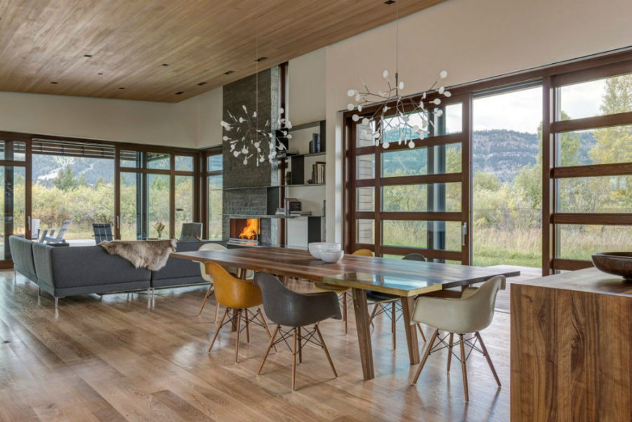Sliding windowed doors open the dining room up to the picturesque outdoors