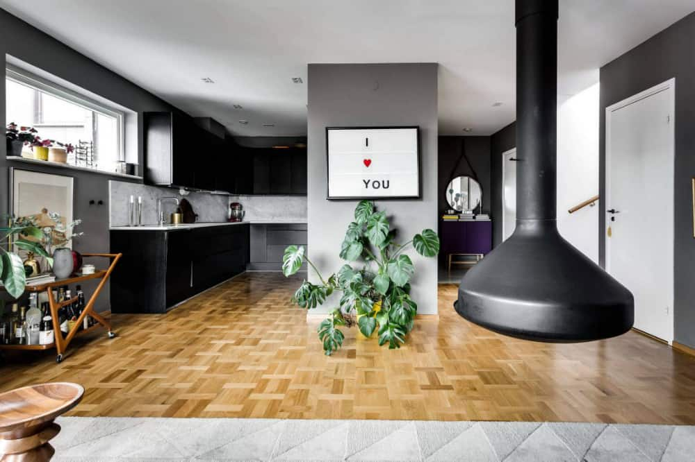 Space pocket next to the hallway includes a stylish black kitchen