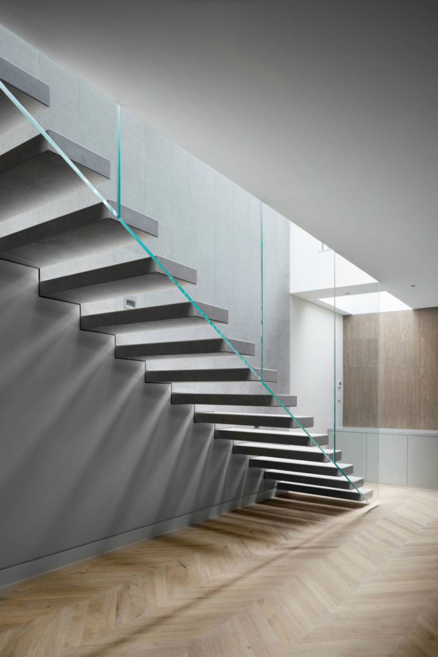 Staircase glass railing leaves the space open and airy