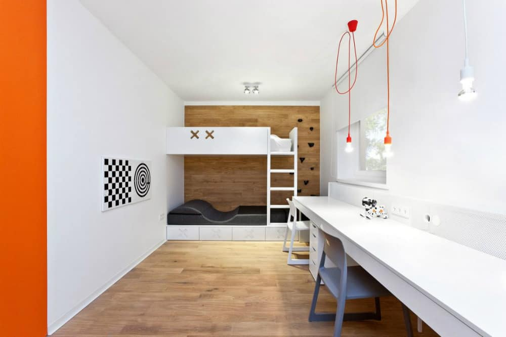 Storage-friendly bunk bed leaves plenty of space for a double-sized desk