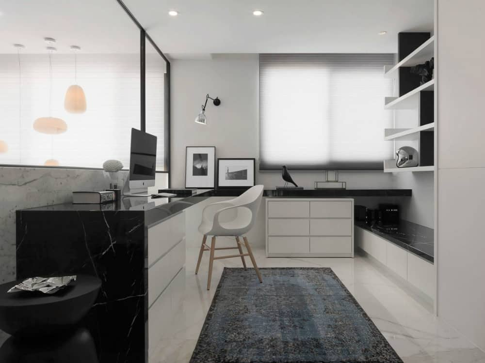 Stylish home office features black marble tabletops