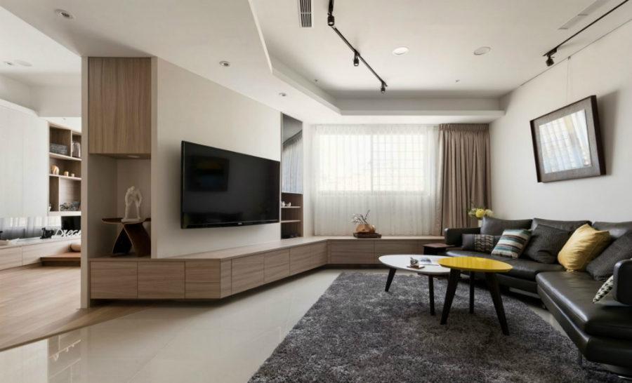 TV wall with a continuous cabinet 900x546 Private Residence in Taipei With an Unusual Layout