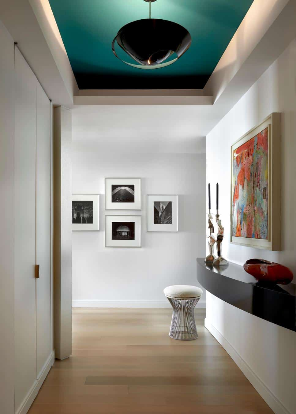 Teal ceiling hallway design by Mitchell Channon Design