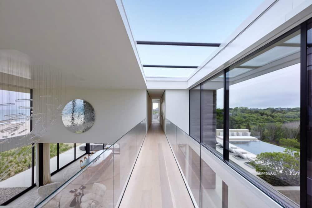 The glass-railed mezzanine catwalk is almost under the atrium