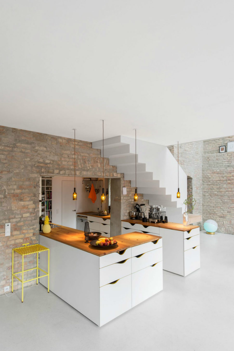 The kitchen has an interesting layout protruding inside a wall 900x1348 19th Century Berlin House Becomes Contemporary With Renovation