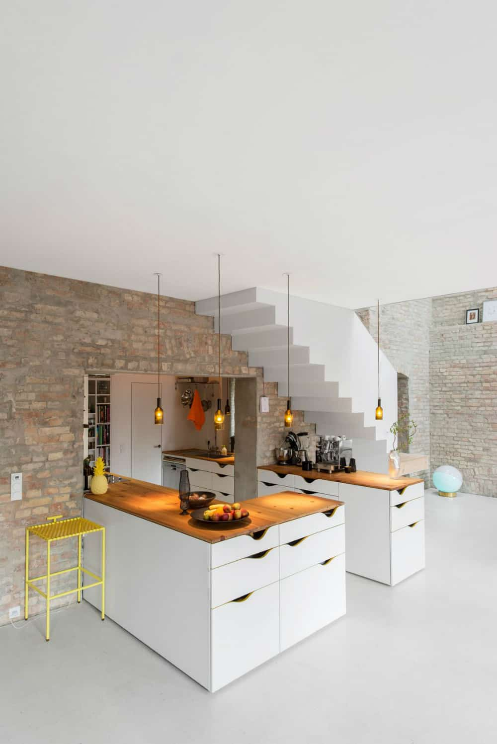 The kitchen has an interesting layout protruding inside a wall