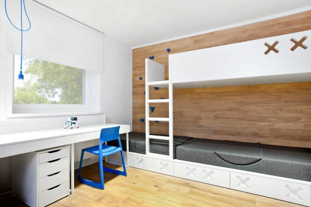 The lower level of the bunk bed can also be used as a sofa
