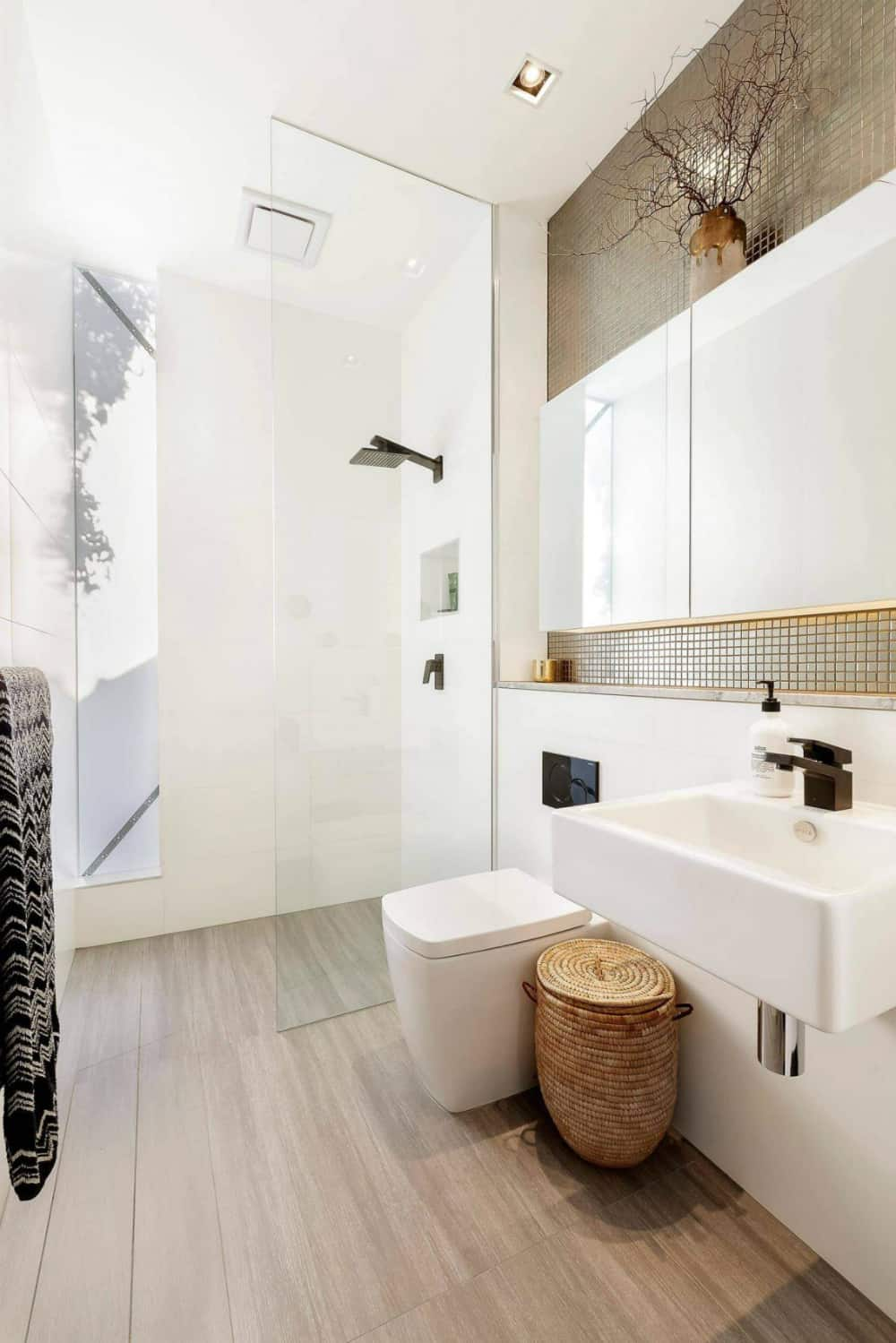 The shower features a glazed inclusion that opens up the space to outdoors