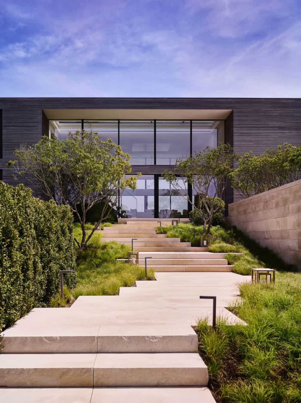 The staircase, leading from driveway, twist and turns to adapt to the landscape