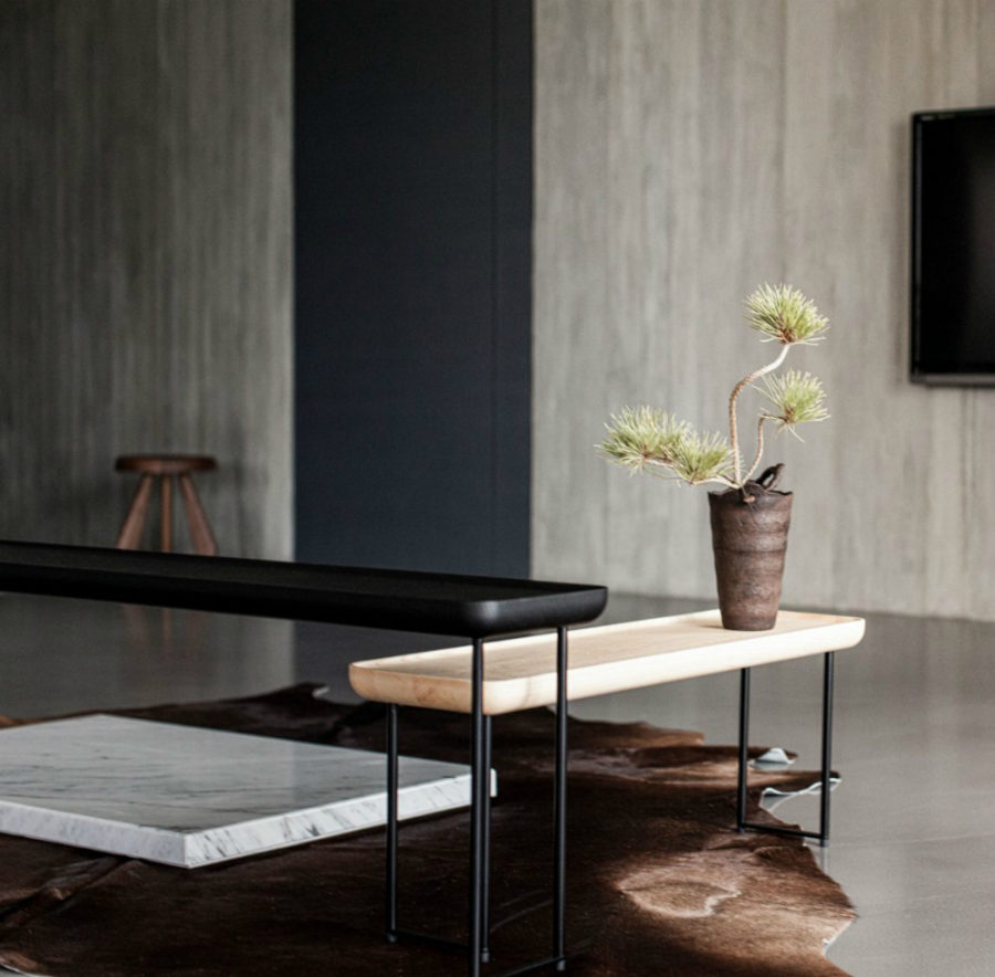 Unconventional coffee tables create a dynamic arrangement