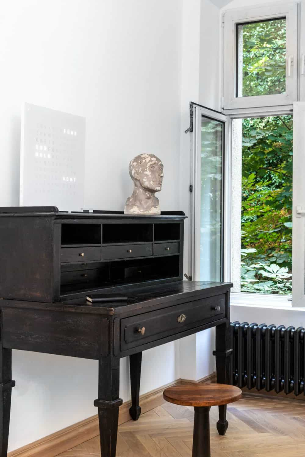 Vintage desk brings a touch of history to the contemporary bedroom